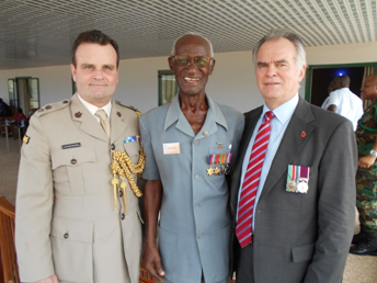Ghana - British DA, Lt Col Ben Richards with LCpl Joshua Ennin (RWAFF) and Controller Welfare attending the Battle of Myohaung Drumhead service and parade in Takoradi.